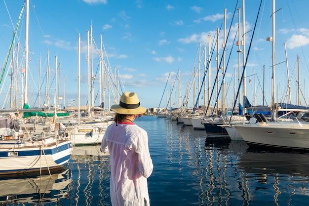 Young woman enjoying at the marina Premium Photo