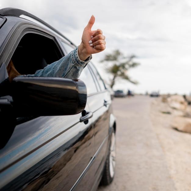 Young woman enjoying road trip Free Photo