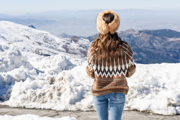 Young woman enjoying the snowy mountains in winter Premium Photo