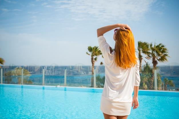 Young woman enjoying sun Free Photo