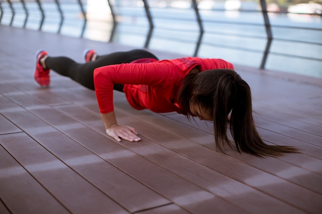 Young woman exercises on the promenade after running Premium Photo