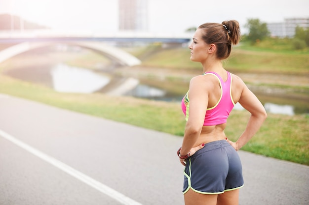 Young woman exercising outdoor. deep breath and she is ready for jogging Free Photo