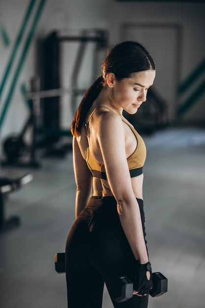Young woman fitness trainer at the gym Free Photo