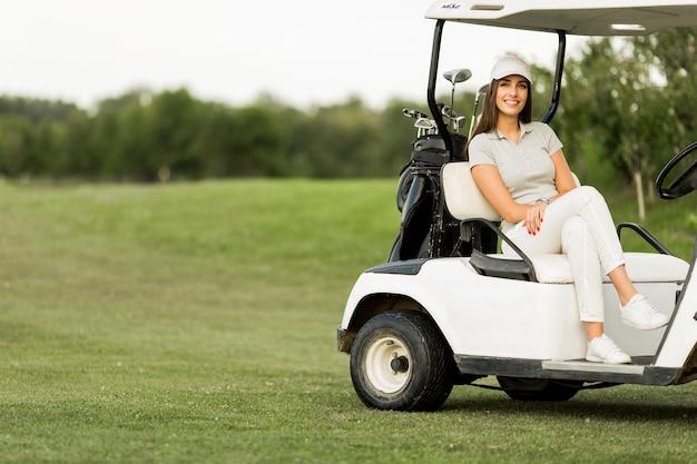 Young woman at golf cart Premium Photo