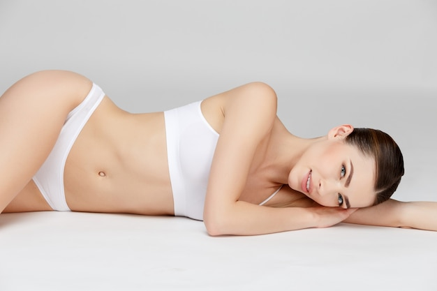 Young woman on gray Premium Photo