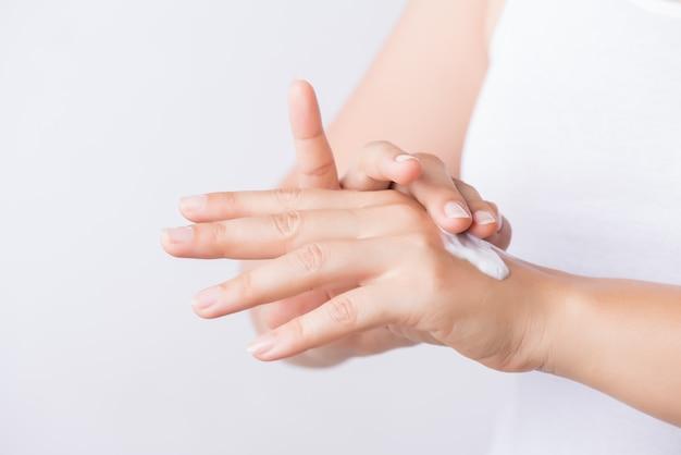 Young woman hands applying moisturizing hand cream. Premium Photo