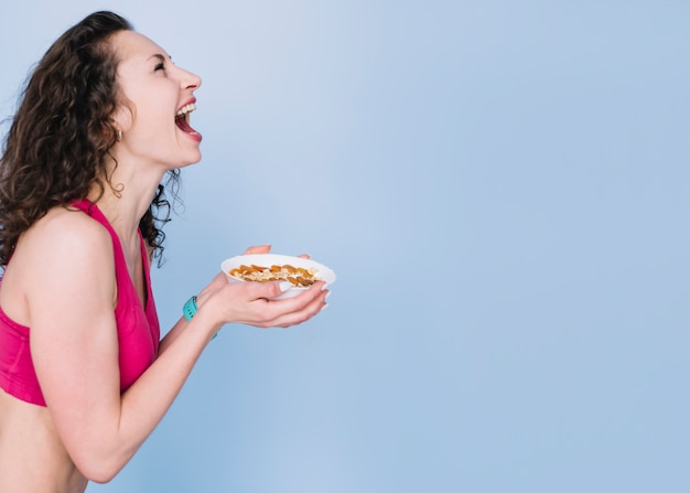 Young woman having a healthy meal Free Photo