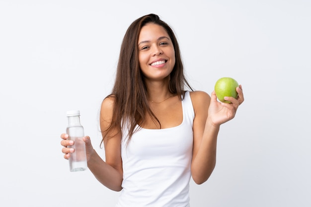 Young woman holding an apple over isolated wall Premium Photo