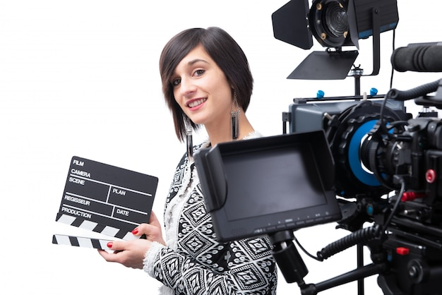 Young woman holding a clapboard. Premium Photo