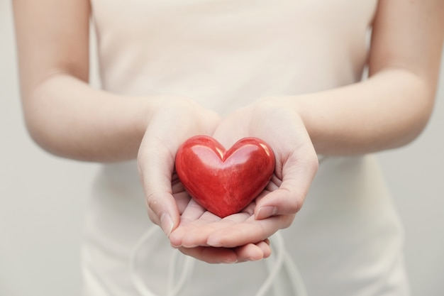 Young woman holding red heart Premium Photo