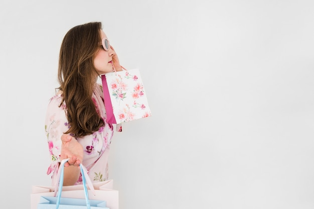 Young woman holding shopping bags Free Photo