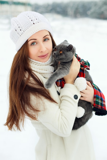 Young woman hugging a cat Free Photo