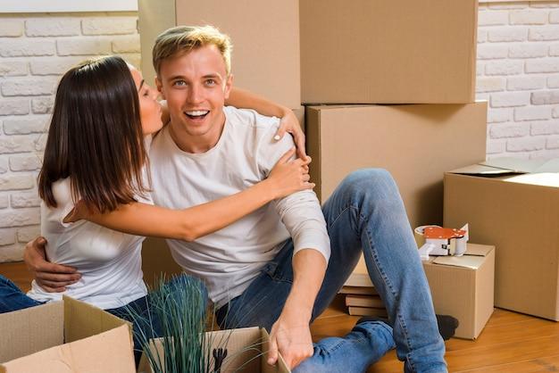 Young woman hugging his boyfriend Free Photo