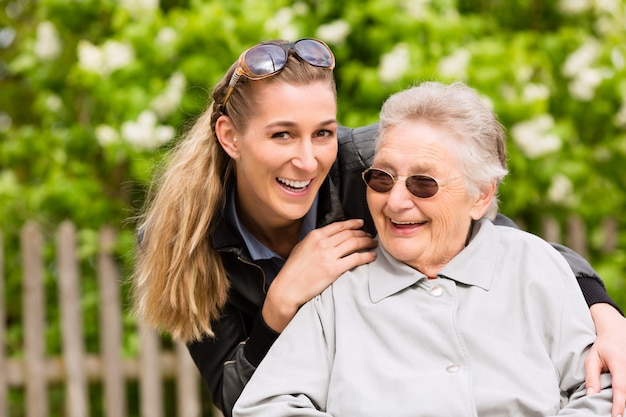 Young woman is visiting her grandmother in nursing home Premium Photo