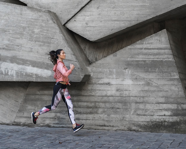Young woman jogging outdoor Free Photo