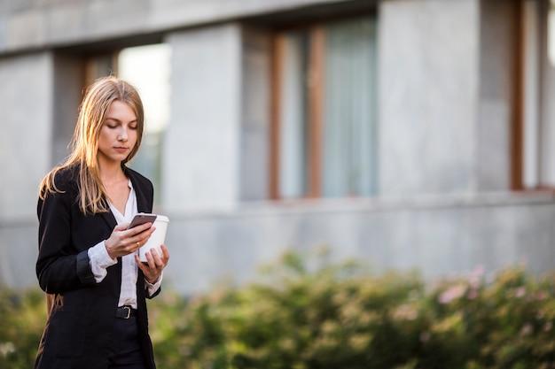 Young woman looking at phone mid shot Free Photo
