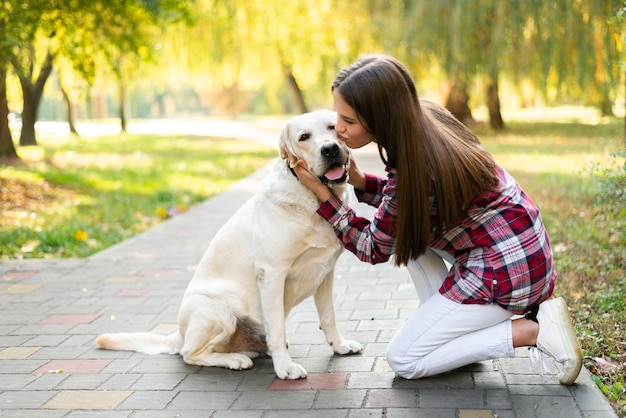 Young woman in love with her dog Free Photo