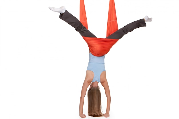 Young woman making antigravity yoga exercises in stretching twine Free Photo