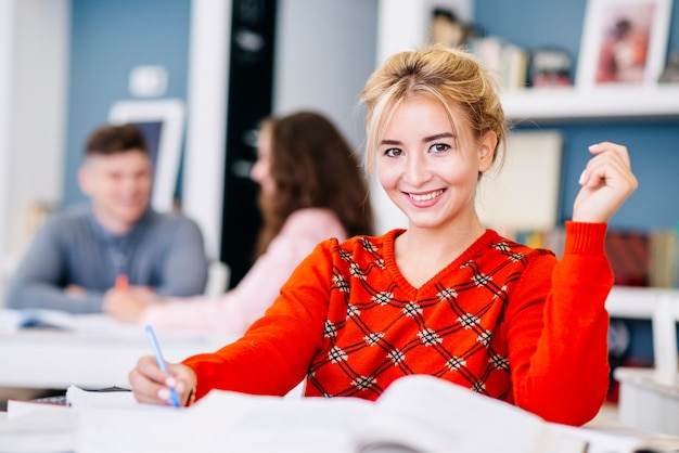 Young woman making notes in study room Free Photo