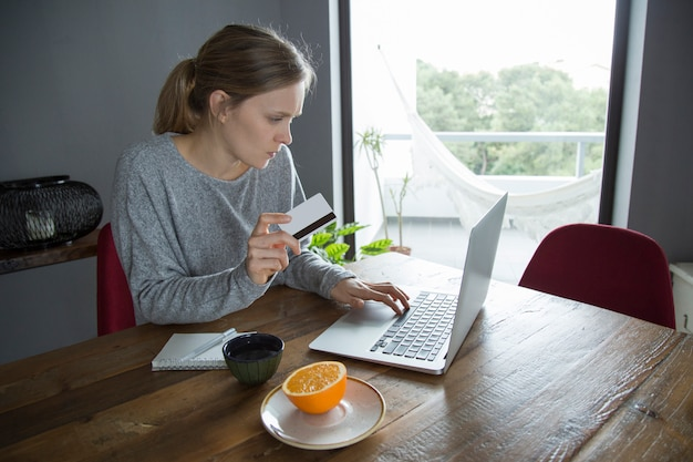 Young woman making online shopping with credit card on pc Free Photo