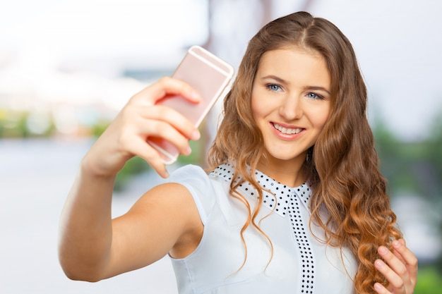 Young woman making a selfie Premium Photo