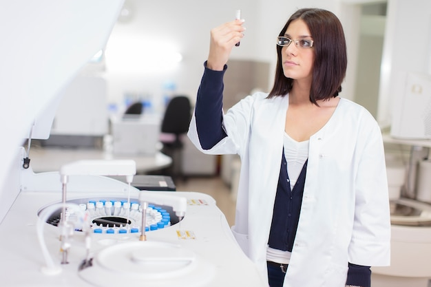 Young woman in the medical laboratory Premium Photo