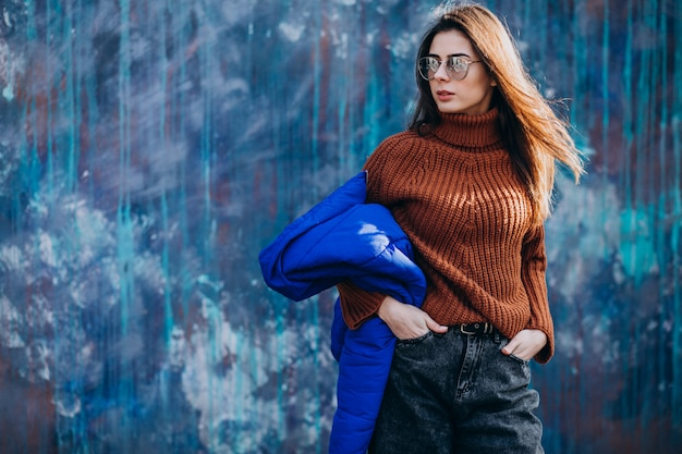 Young woman model in blue winter jacket Free Photo