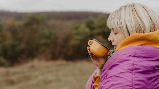 Young woman in nature drinking tea Free Photo