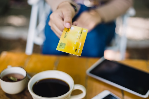 Young woman paying for cafe by credit card Premium Photo