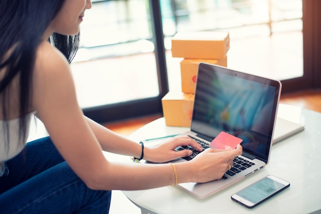 Young woman paying shopping online with a credit card at home Premium Photo