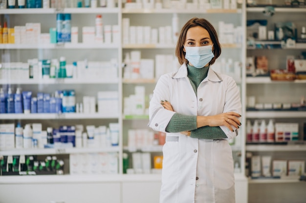 Young woman pharmacist at pharmacy Free Photo