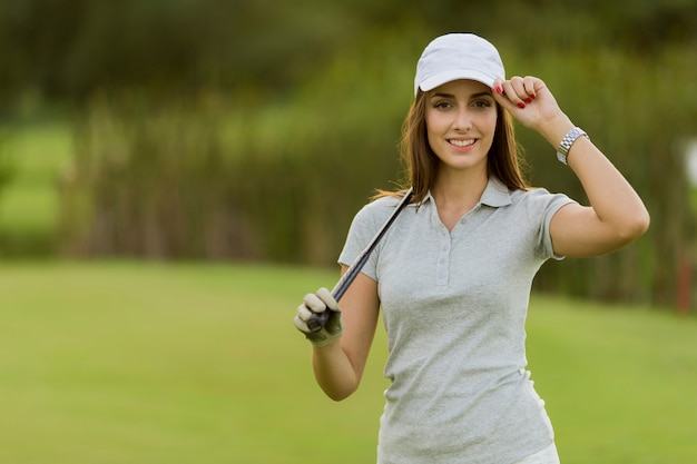Young woman playing golf Premium Photo