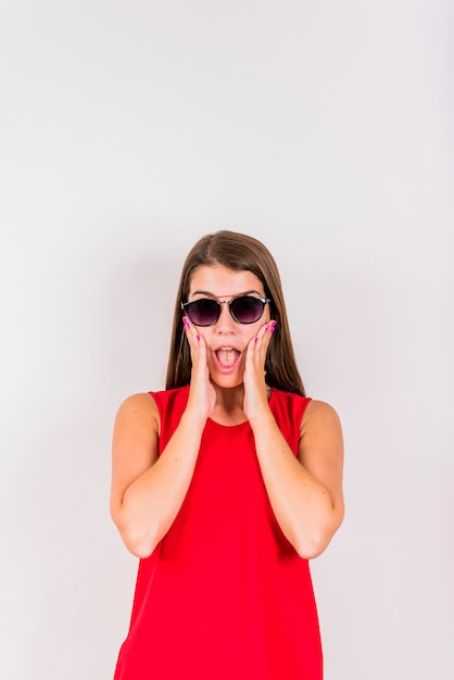 Young woman posing while surprising Free Photo