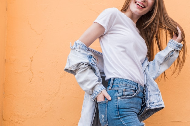 Young woman posing with hand's in pocket Free Photo