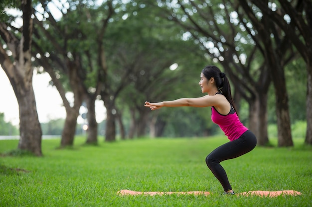 Young woman practicing yoga in park | Premium Photo