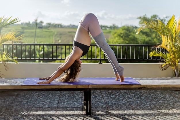 Young woman practicing yoga Free Photo