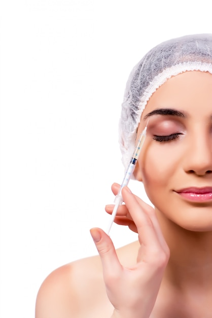 Young woman preparing for plastic surgery isolated on white Premium Photo