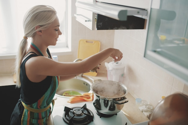 Young woman preparing pumpkin soup Free Photo