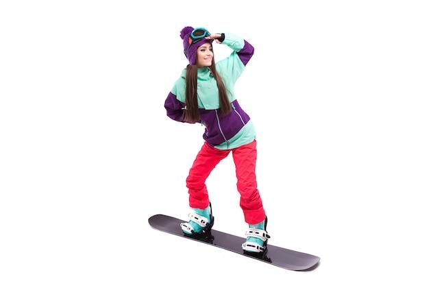 Young woman in purple ski costume ride snowboard Premium Photo