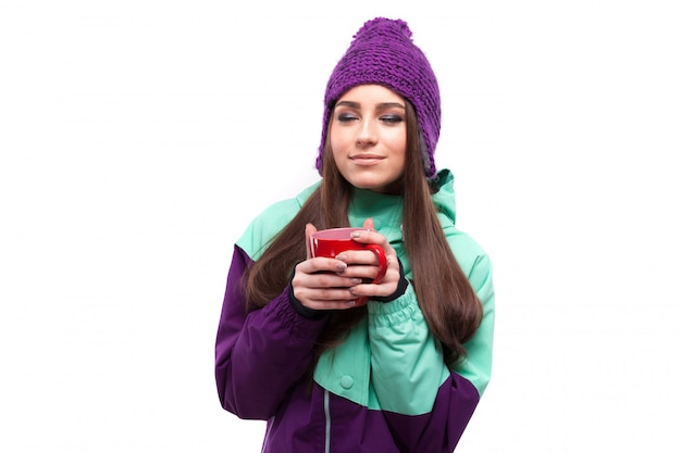 Young woman in purple ski suit hold red cup Premium Photo