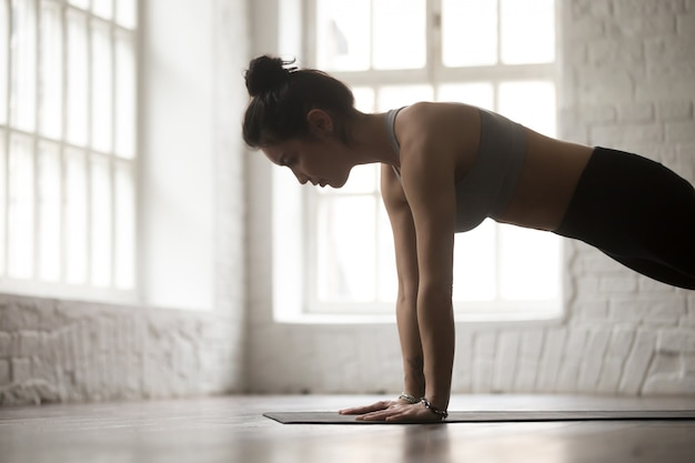 Young woman in push ups or press ups pose, closeup Free Photo