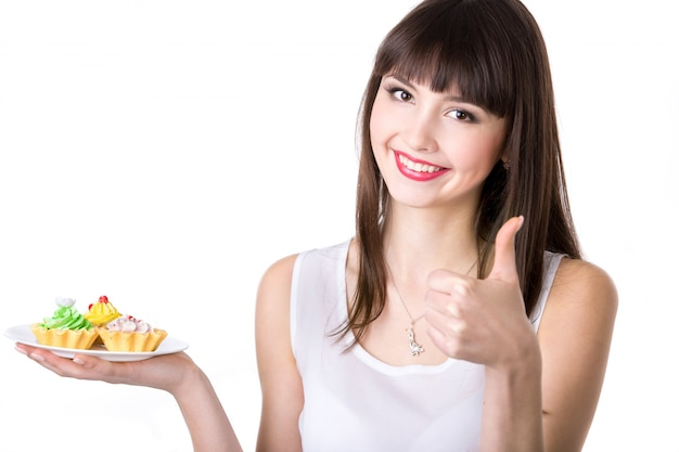 Young woman recommending cakes Free Photo