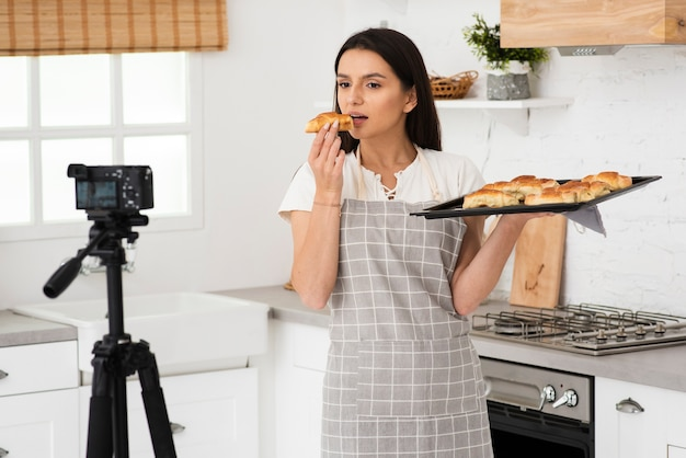 Young woman recording while cooking Free Photo