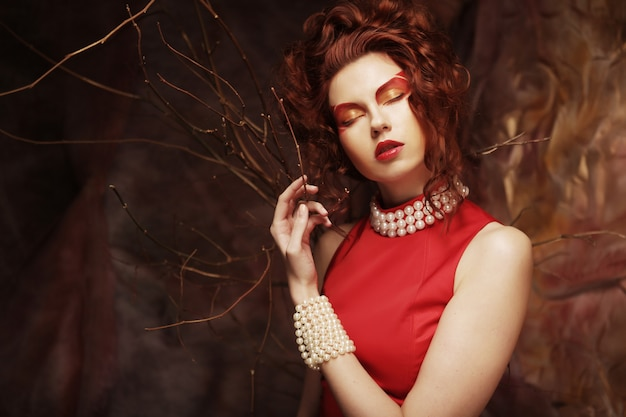 Young woman in red dress Premium Photo