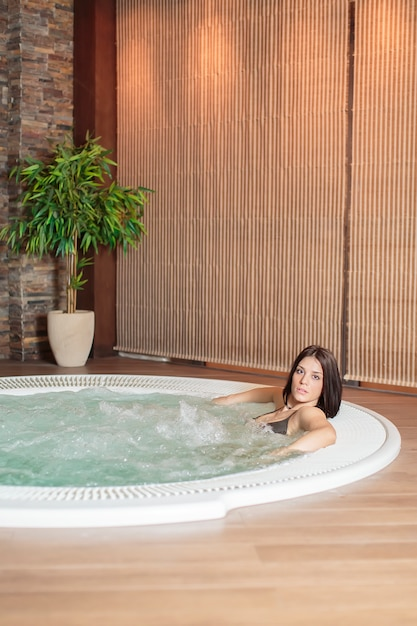 Young woman relaxing in the hot tub Premium Photo