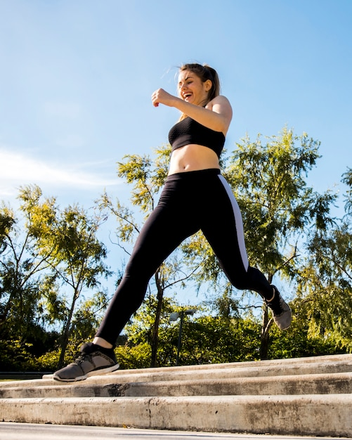 Young woman running outdoors with sportswear Free Photo