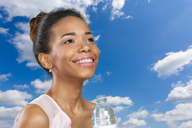 Young woman showing a bottle of water Premium Photo