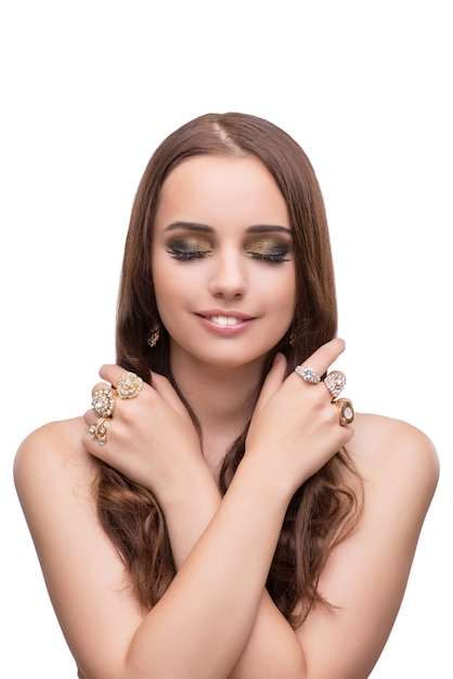Young woman showing off her jewellery isolated on white Premium Photo