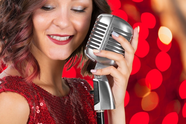 Young woman singer Premium Photo