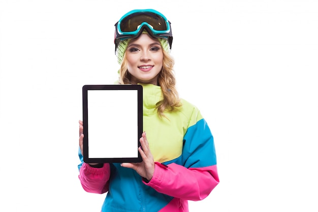 Young woman in ski suit show empty tablet Premium Photo